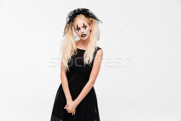 Pretty blonde woman dressed in black widow costume Stock photo © deandrobot