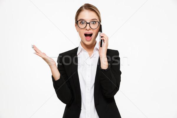 Stock fotó: Meglepődött · boldog · szőke · nő · üzletasszony · szemüveg · beszél