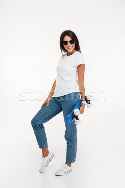 Teljes alakos portré mosolyog vonzó nő napszemüveg pózol Stock fotó © deandrobot