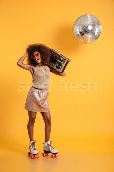 Full length portrait of charming african woman in retro clothes  Stock photo © deandrobot