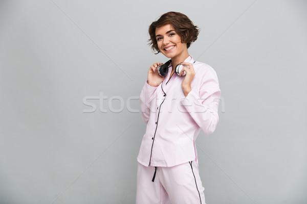 Portret wesoły uśmiechnięty dziewczyna piżama słuchawki Zdjęcia stock © deandrobot