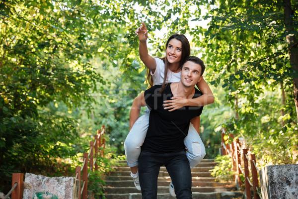 Jovem feliz casal piggyback parque Foto stock © deandrobot