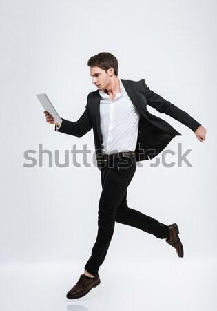 Full length portrait of a smiling handsome businessman Stock photo © deandrobot