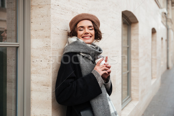 Portrait of a delighted girl dressed in autumn clothes Stock photo © deandrobot