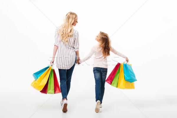 Back view of a young mother and her little daughter Stock photo © deandrobot