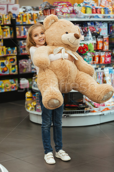 Happy little girl holding big teddy bear Stock photo © deandrobot