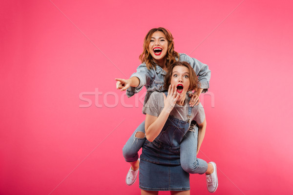 Excited amazing two women friends have fun Stock photo © deandrobot