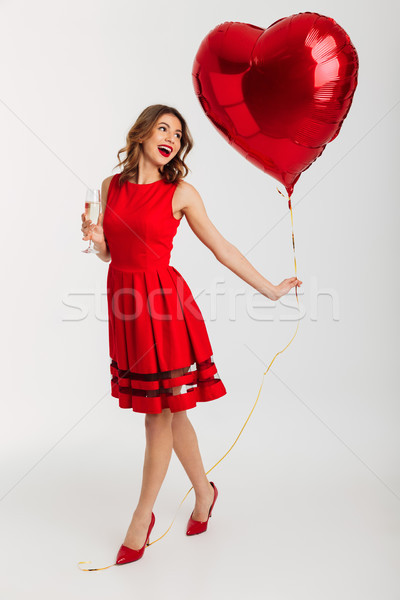 Full length portrait of a cheery young woman Stock photo © deandrobot