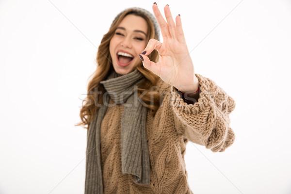 Sorridente jovem senhora okay gesto Foto stock © deandrobot