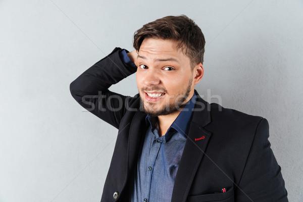 Ritratto confusi imprenditore testa isolato grigio Foto d'archivio © deandrobot