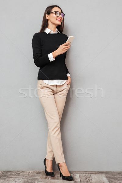 Imagem feliz asiático mulher negócio Foto stock © deandrobot