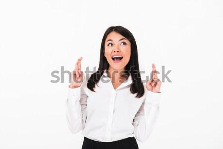 Portrait of a cheery asian businesswoman Stock photo © deandrobot
