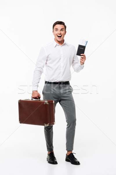 Full length portrait of a smiling happy man in white shirt Stock photo © deandrobot