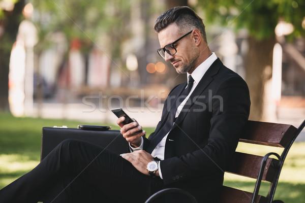 Portré sikeres üzletember hivatalos ruházat ül Stock fotó © deandrobot