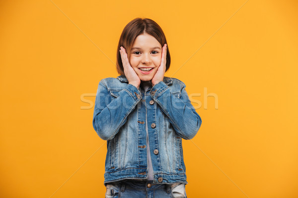 Portrait of a smiling little schoolgirl looking at camera Stock photo © deandrobot