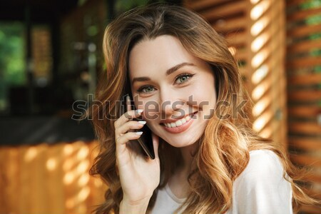 Stock photo: Close up portrait of a smiling young girl talking