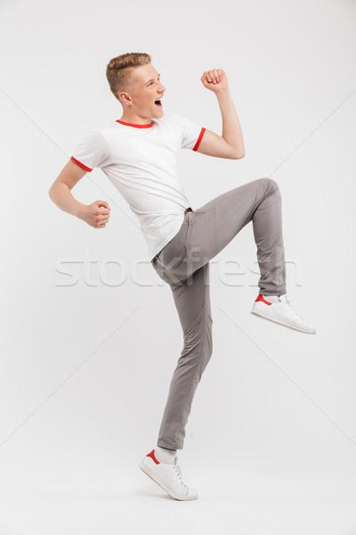 Teljes alakos portré derűs tizenéves fiú ünnepel siker Stock fotó © deandrobot