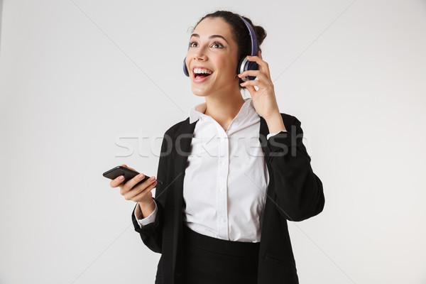 Сток-фото: возбужденный · молодые · деловой · женщины · прослушивании · музыку