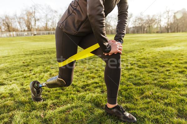 Fotó mozgássérült lány tréningruha testmozgás láb Stock fotó © deandrobot