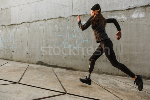 Portrait of disabled athlete woman with prosthetic leg in tracks Stock photo © deandrobot