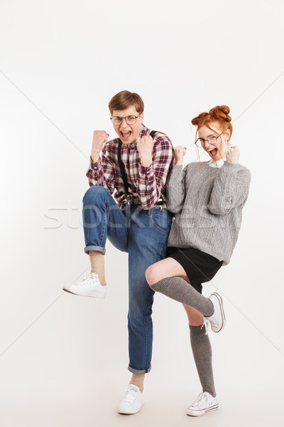 Full length portrait of a happy couple of school nerds Stock photo © deandrobot