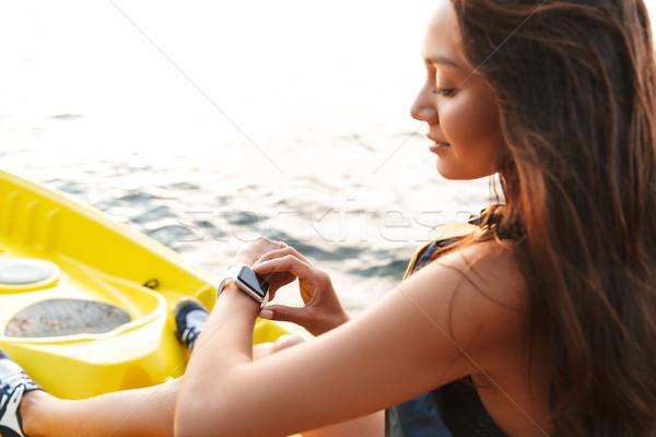 Jonge vrouw kajakken meer zee boot horloge Stockfoto © deandrobot