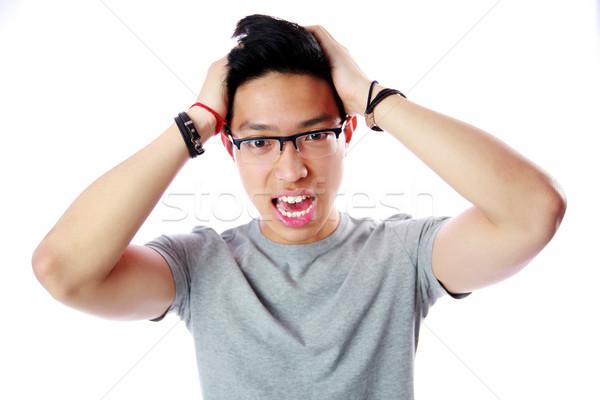 Portret bange jonge asian man witte Stockfoto © deandrobot