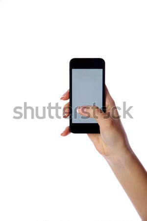 Closeup portrait of a female hand holding smartphone isolated on white background Stock photo © deandrobot