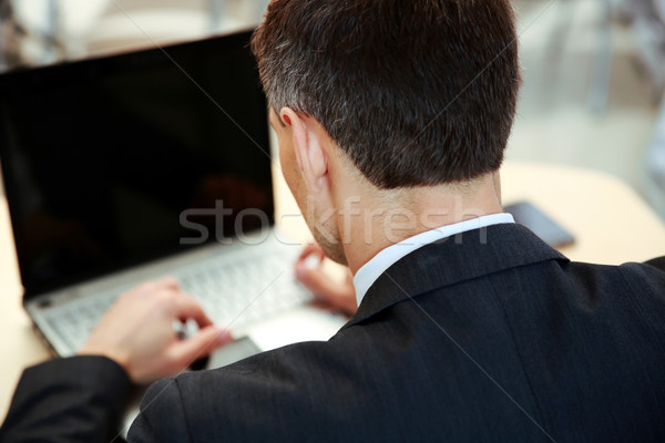 Businessman working on laptop. View from above Stock photo © deandrobot