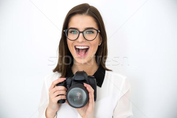 Maravilhado jovem bela mulher câmera negócio Foto stock © deandrobot