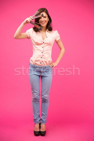 Smiling woman holding brushes  Stock photo © deandrobot
