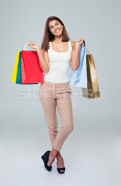 Pretty happy woman holding shopping bags Stock photo © deandrobot