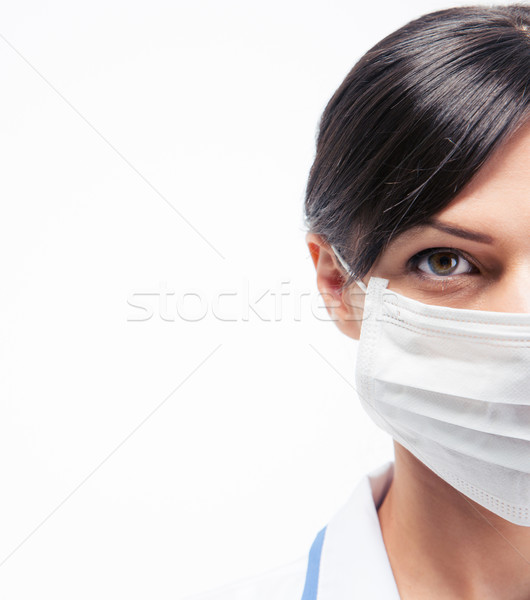Cropped image of a female medical doctor in mask  Stock photo © deandrobot