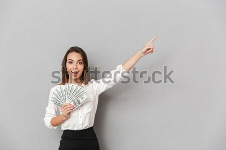 Woman in rabbit ears pointing finger at camera  Stock photo © deandrobot