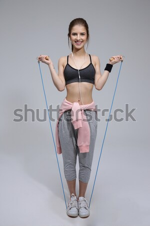 Sports woman holding shaker and looking away  Stock photo © deandrobot