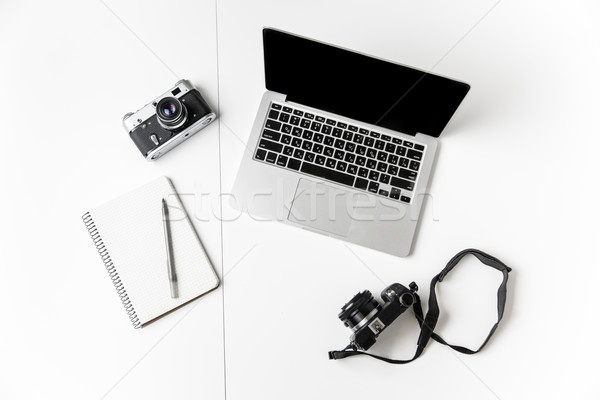Two cameras, notepad with pen and blank screen laptop  Stock photo © deandrobot