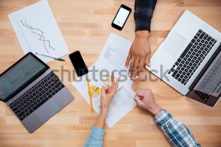 Group of people making decision together  Stock photo © deandrobot
