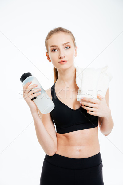 スポーツウーマン 立って ボトル 水 白 タオル ストックフォト © deandrobot