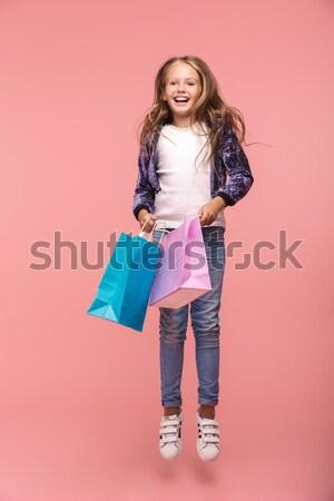 Töprengő csinos fiatal nő kockás póló mellény Stock fotó © deandrobot