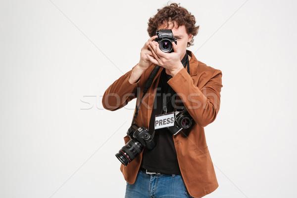 Férfi riporter készít fotó kamera izolált Stock fotó © deandrobot