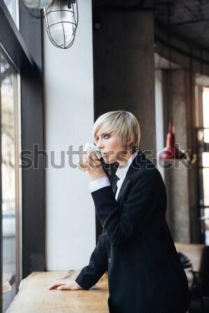 Güzel genç kadın ayakta pencere eşiği kafe pencere Stok fotoğraf © deandrobot