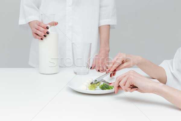 Close-up of hands during lunch at the table Stock photo © deandrobot