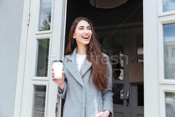 Happy young trendy woman drinking take away coffee Stock photo © deandrobot