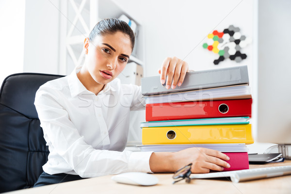 Attractive tired businesswoman sitting at workplace Stock photo © deandrobot