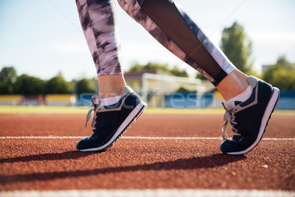 Close up portrait of a female runner feet running Stock photo © deandrobot