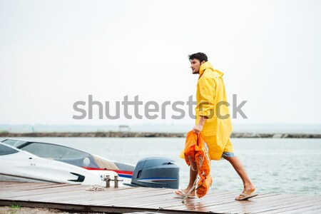 Młodych przystojny marynarz człowiek spaceru morza Zdjęcia stock © deandrobot