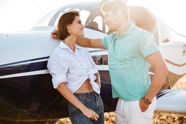 Couple talking and flirting near private airplane Stock photo © deandrobot