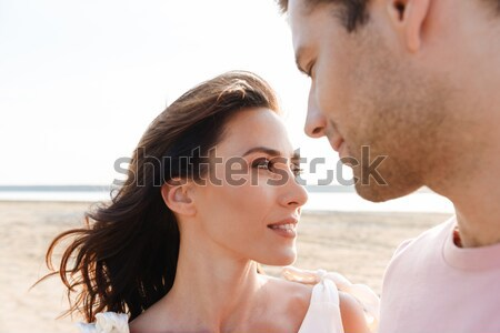 Couple standing and huging outdoors on sunset Stock photo © deandrobot