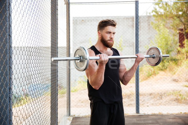 Musculaire fitness homme lourd exercice barbell Photo stock © deandrobot