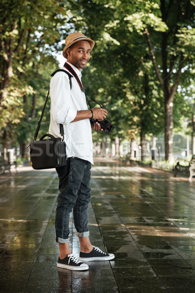 Siyah adam park şapka kamera adam mutlu Stok fotoğraf © deandrobot